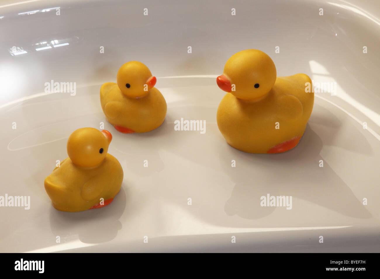 Yellow rubber ducks on a bath Stock Photo