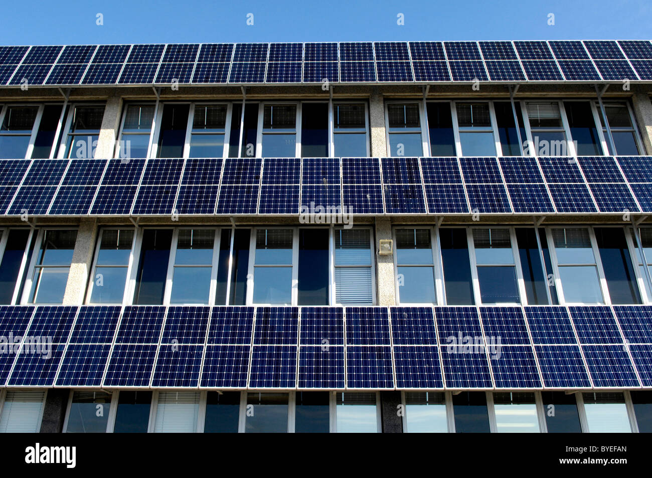 Rows Of Photovoltaic Solar Panels On The Side Of A Council