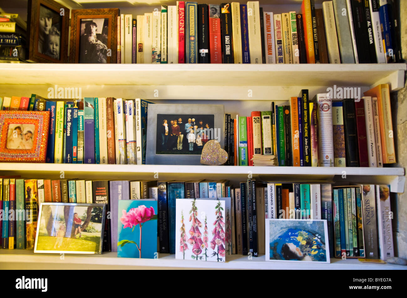 Bookshelf with family photos and cards - Stock Image
