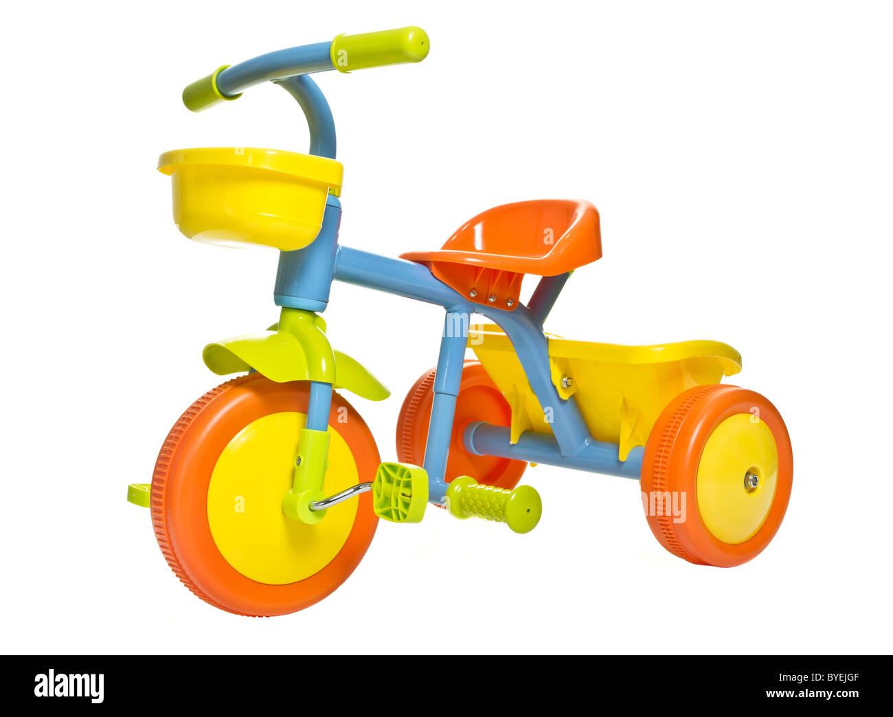 Vibrant child's 1st bike / trike isolated on white. Stock Photo
