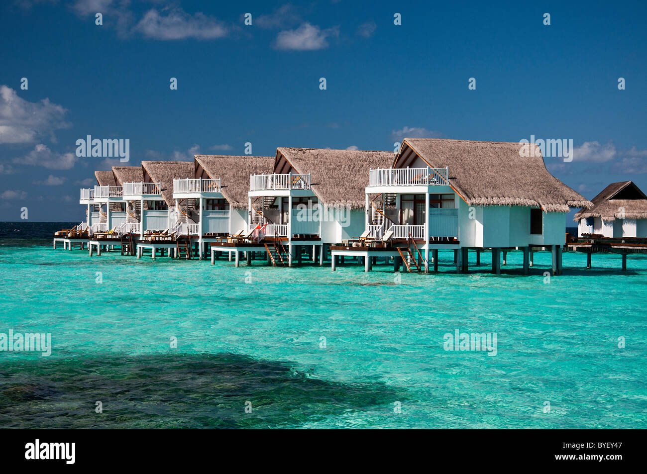 grand centara island maldives white sands blue sky turquoise sea honeymoon water bungalow - Stock Image