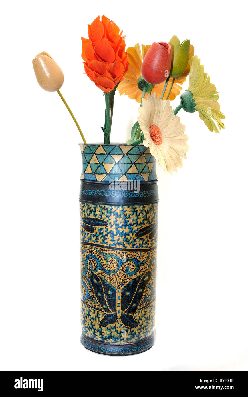 ornae wooden vase with wooden flowers for decoration. Isolated on white. - Stock Image