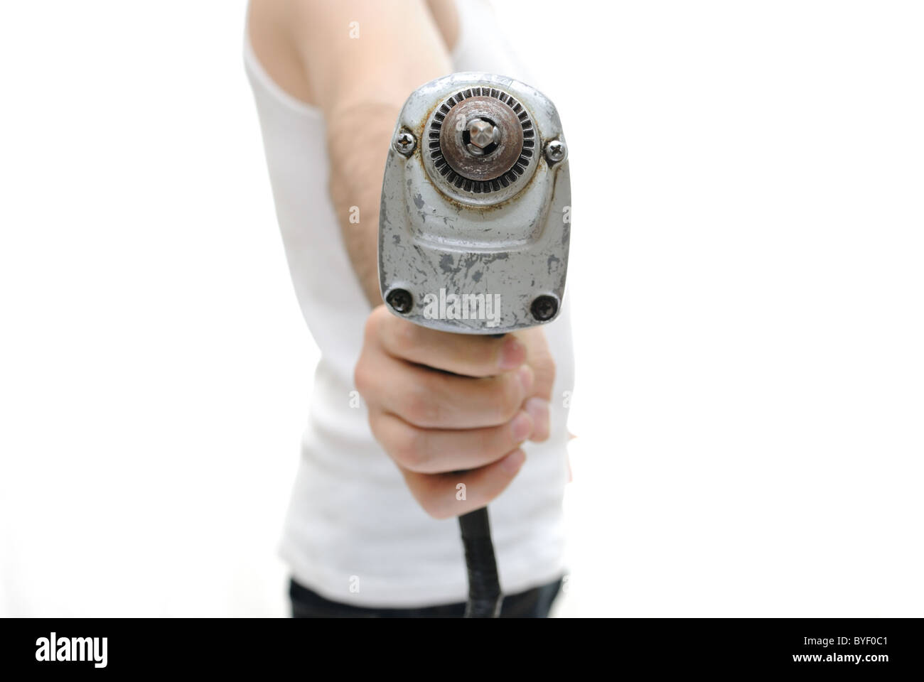 Carpenter with an electric vintage drill - Stock Image