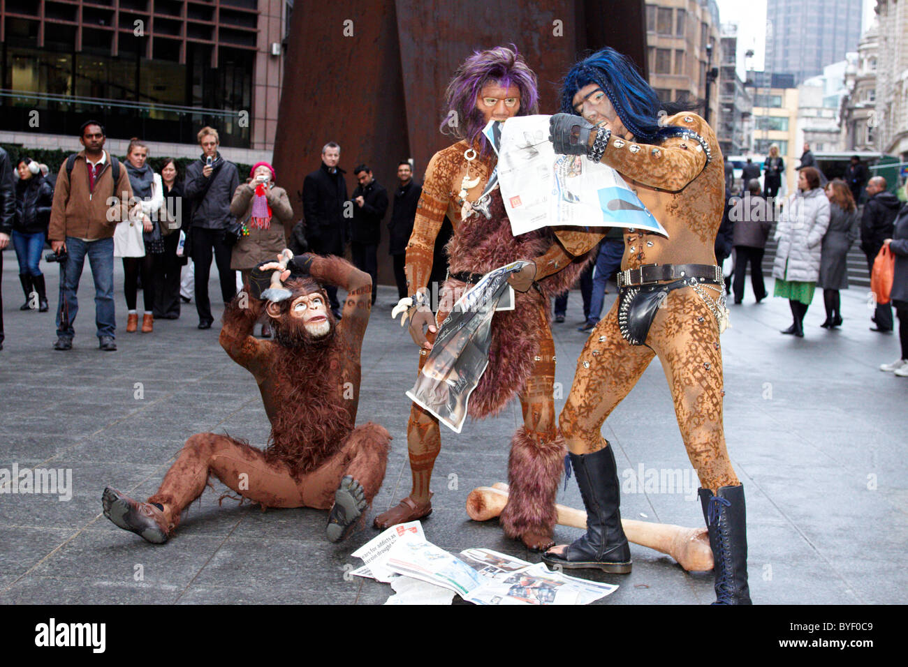Cast members from Cirque du Soleil's Totem recreated Darwin's iconic evolution of man scene in Liverpool - Stock Image