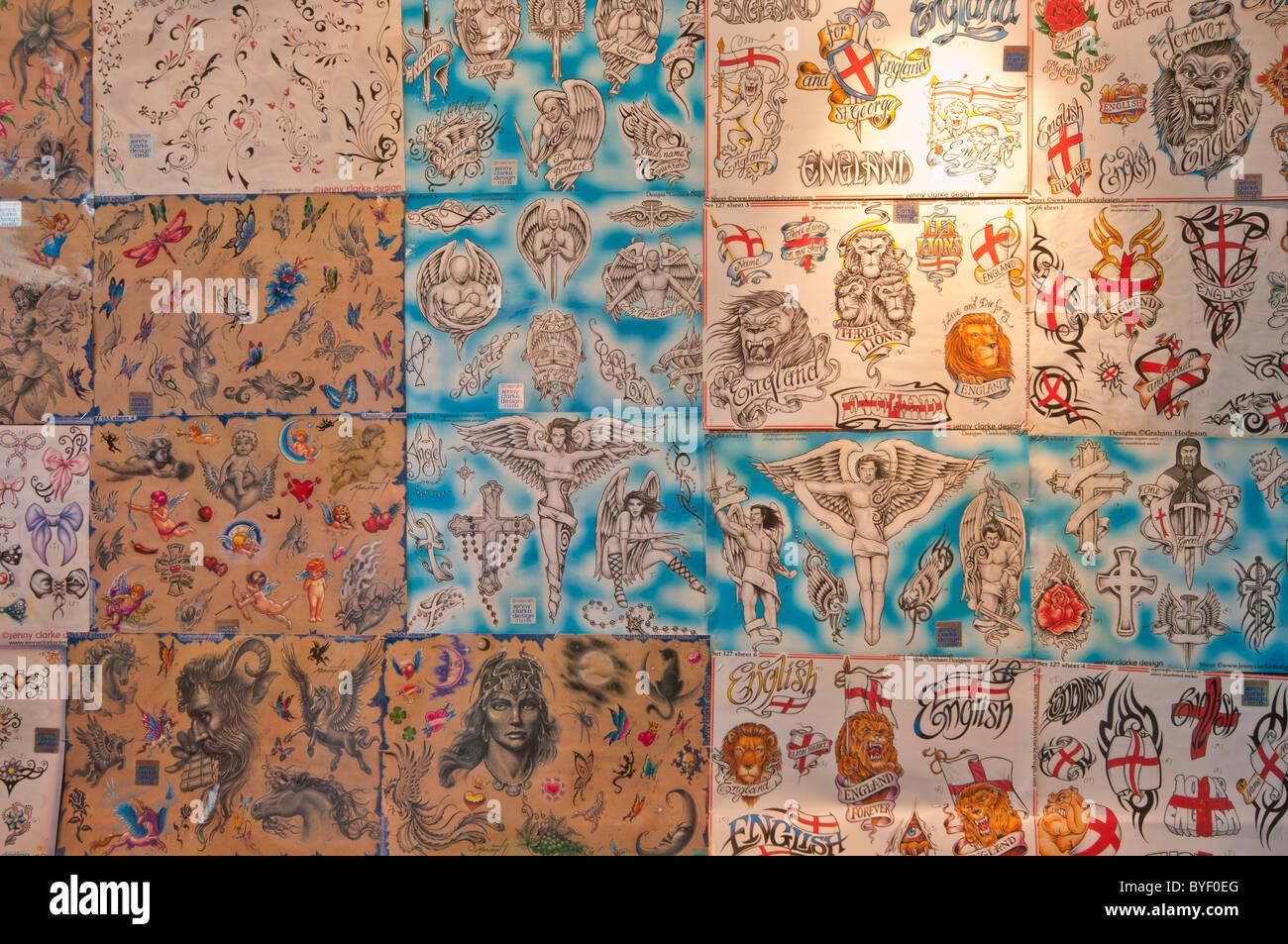 Tattoo Display On A Wall Of A Tattoo Studio - Stock Image