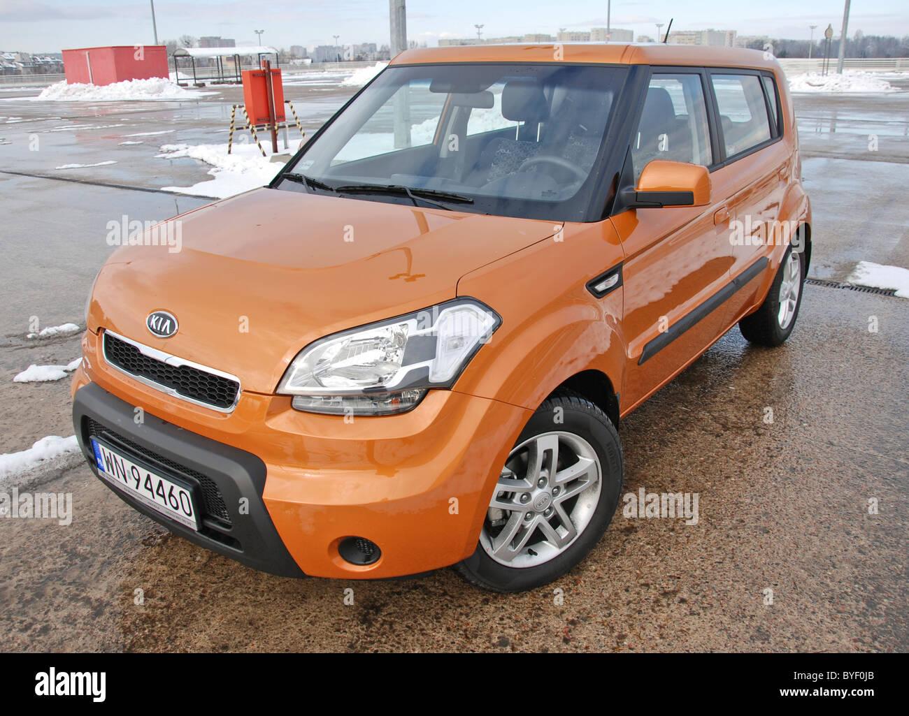 Kia Soul 1.6 - MY 2008 - orange - five doors (5D) - Korean popular subcompact mini van car, small MPV - park space, Stock Photo