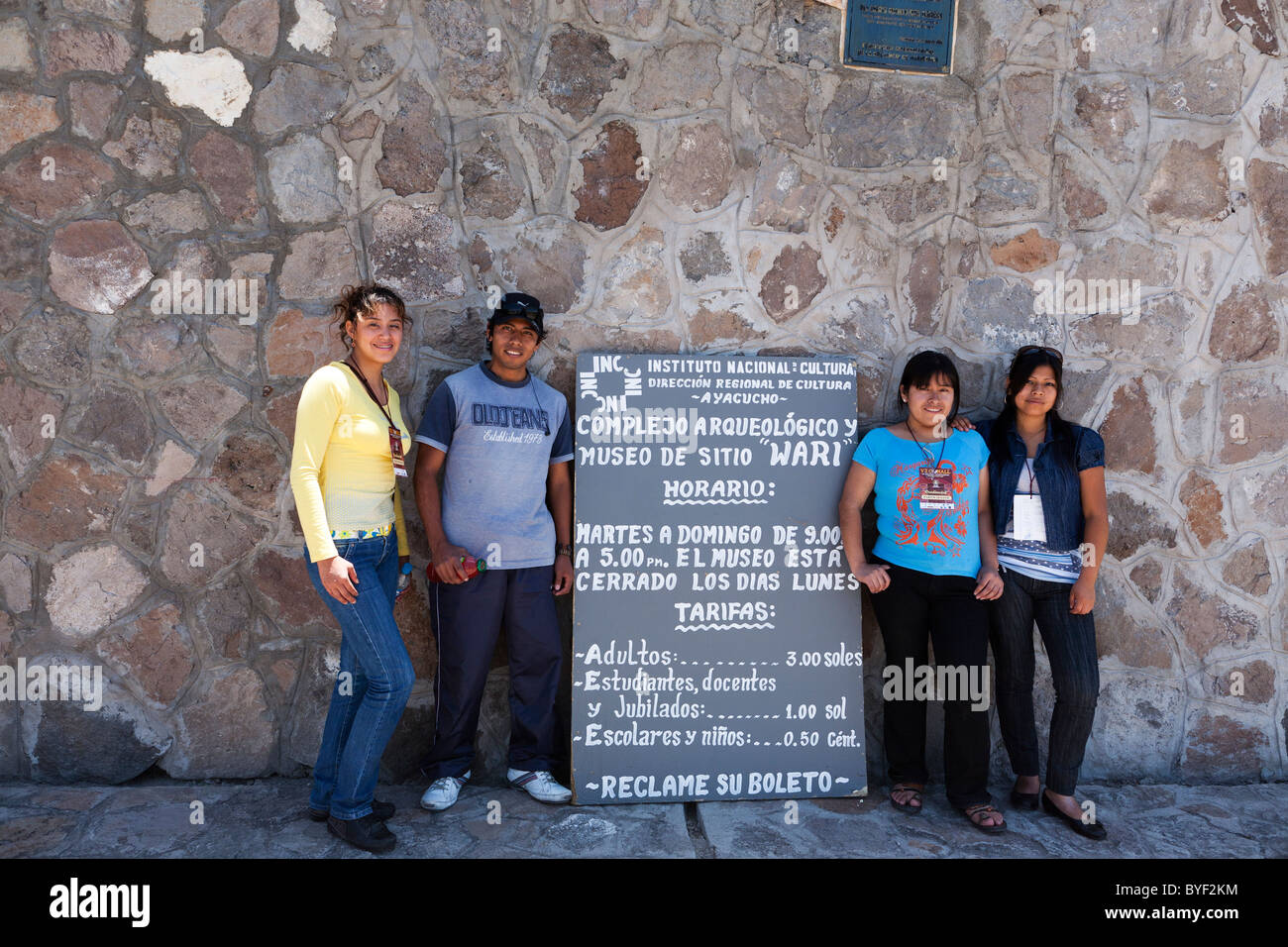 A group of Peruvian students stand outside the ruins of the Wari culture in the Andes 20km from the town of Ayacucho Stock Photo