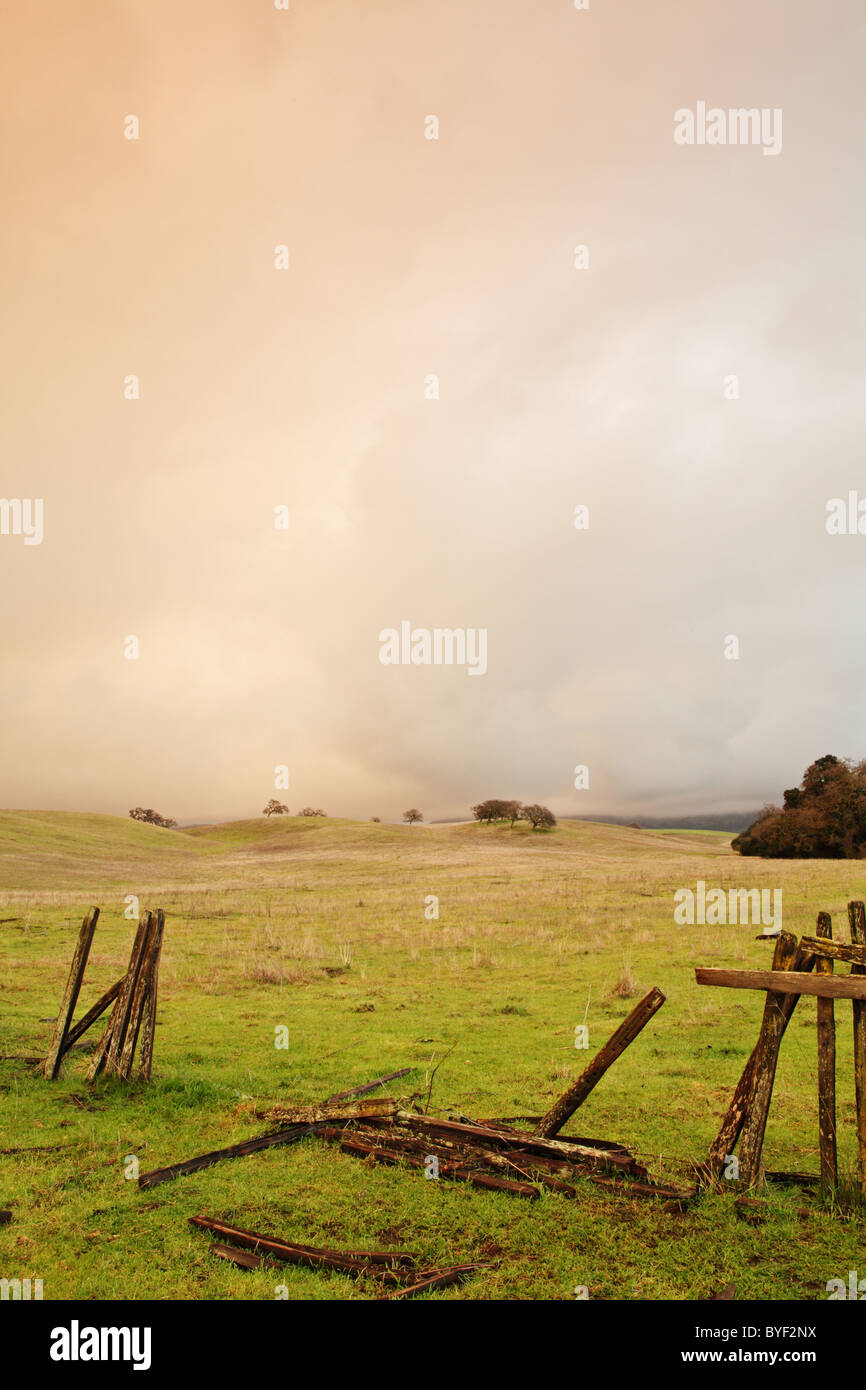 A broken farm fence after the storm - Stock Image