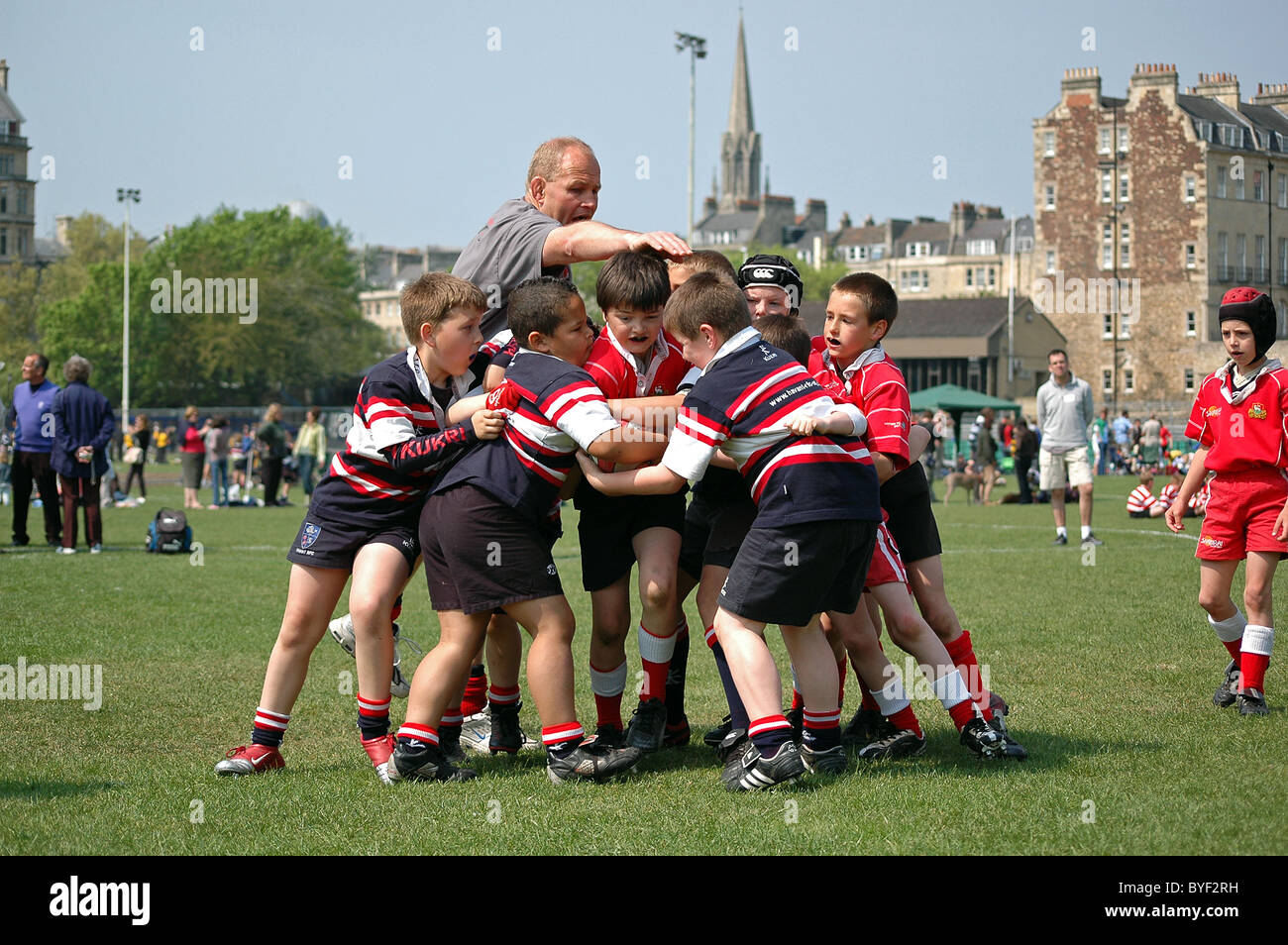 Primary school children playing in a rugby tournament at Bath, UK - Stock Image