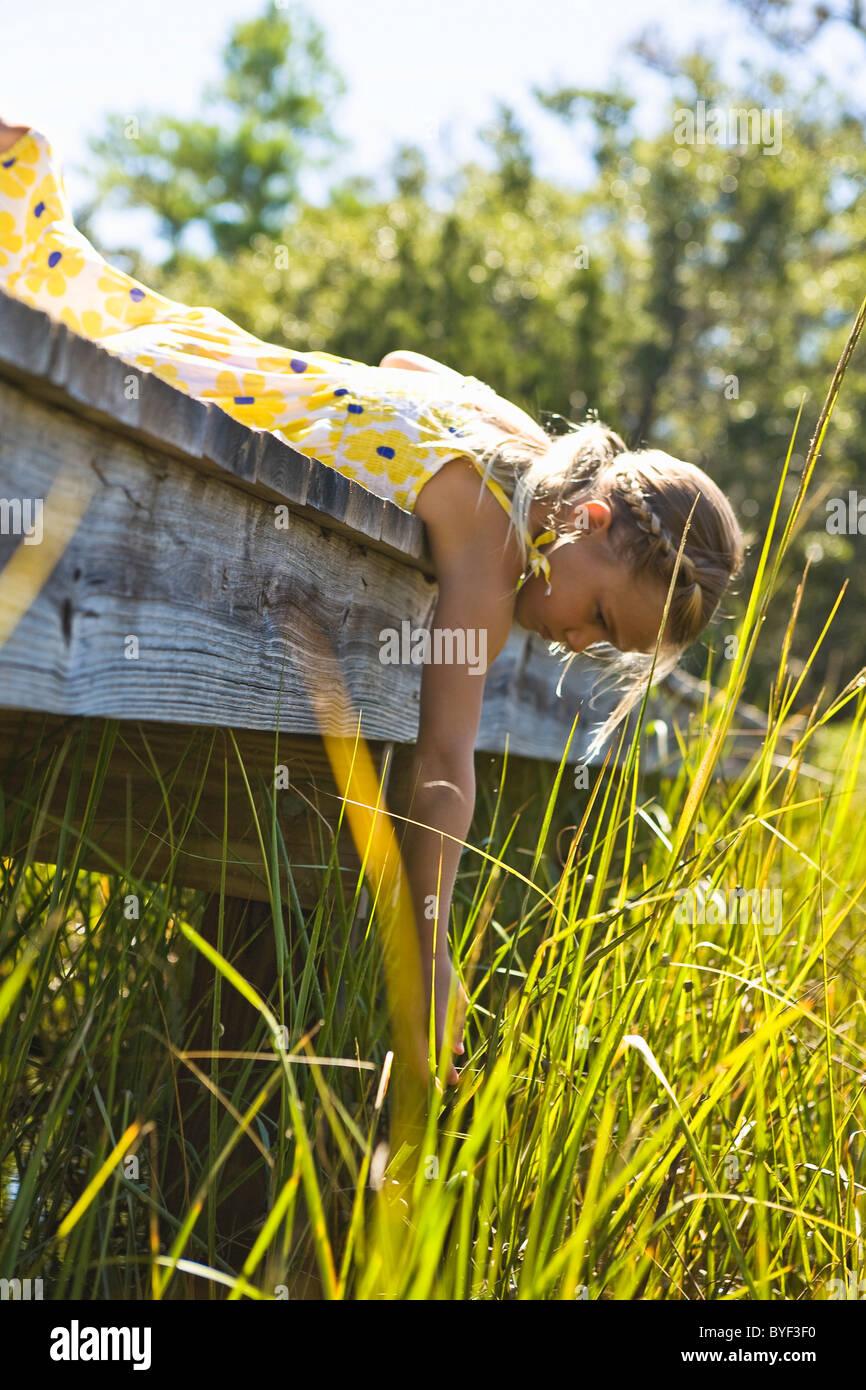 Child exploring on Boardwalk Bald Head Island, North Carolina - Stock Image