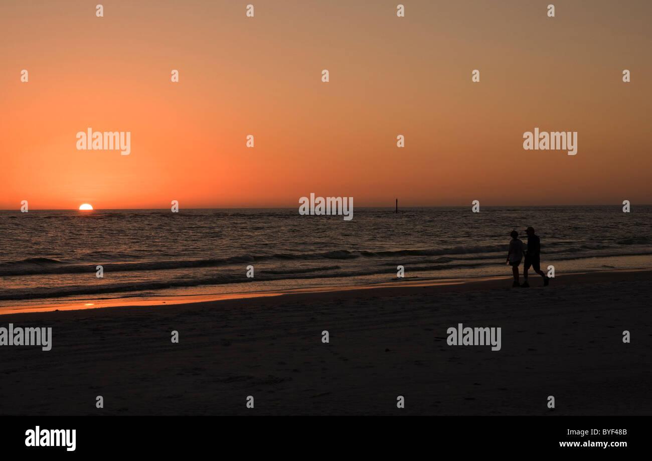 Couple walking in sunset Siesta Key Beach Florida Sarasota USA. Stock Photo