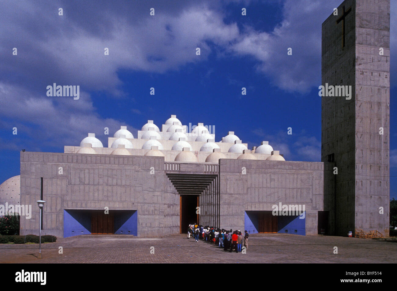 School children lined up in front of the new cathedral or Catedral de la Inmaculada Concepcion de Maria in Managua, Stock Photo