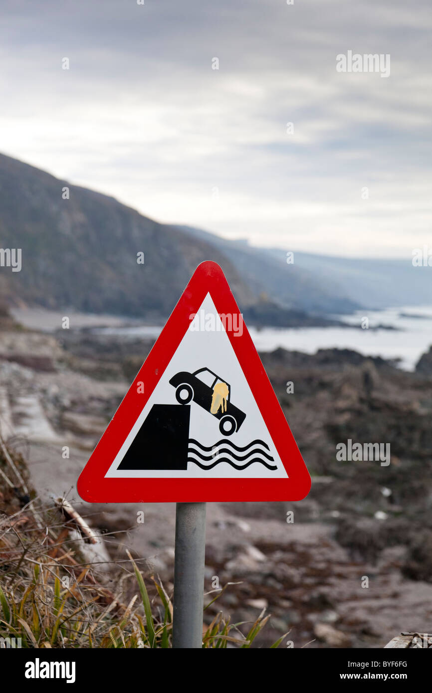 Road warning sign on a beach side road in Cornwall, England. - Stock Image