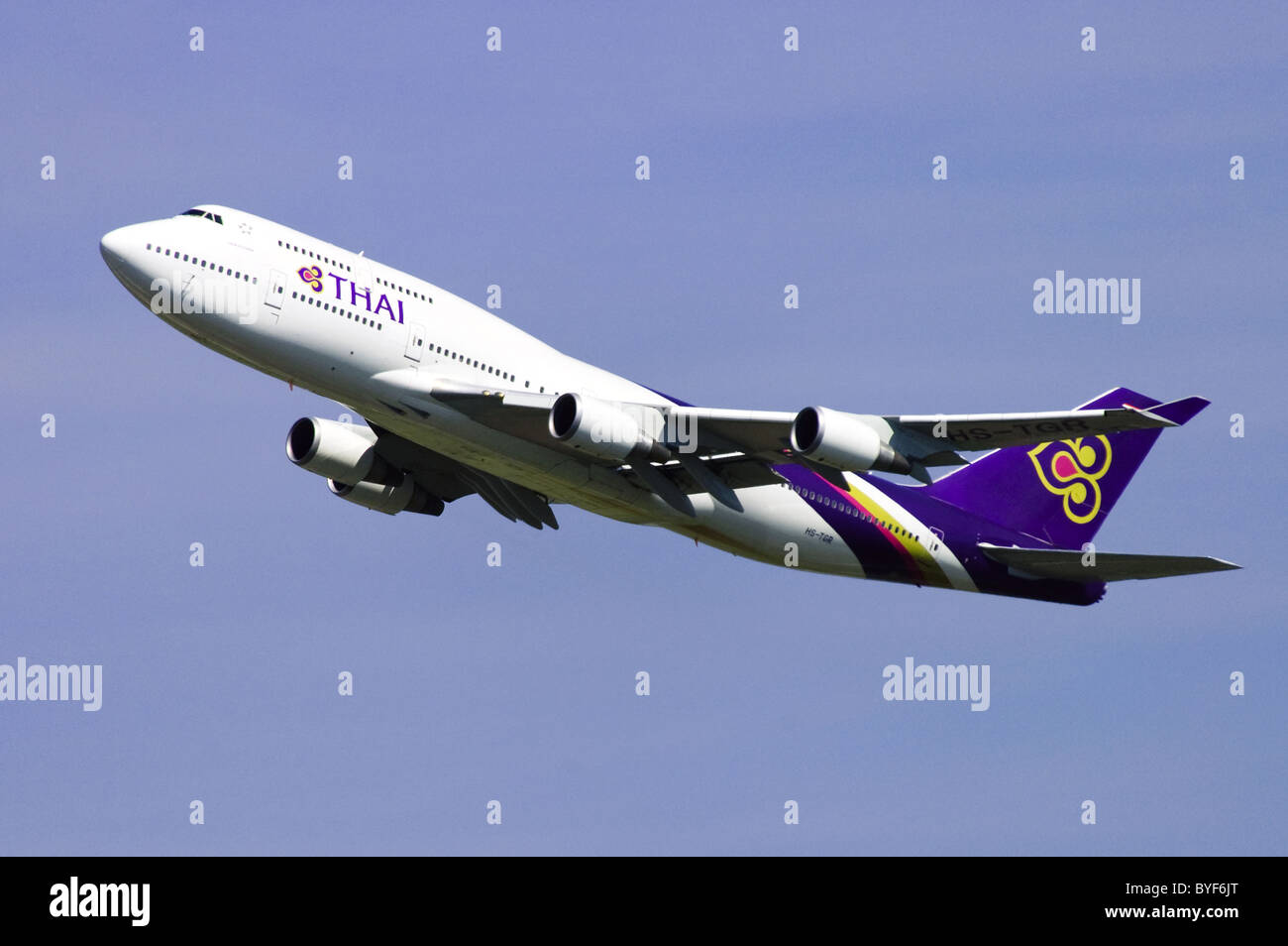 Boeing 747 jumbo jet operated by Thai Airways climbing out after take off from London Heathrow Airport Stock Photo