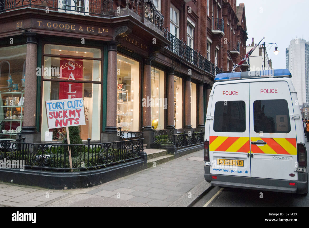 'Tory Cuts Suck my Nuts'  protest banner outside Thomas Goode fine china store South Audley Street W1 London. - Stock Image