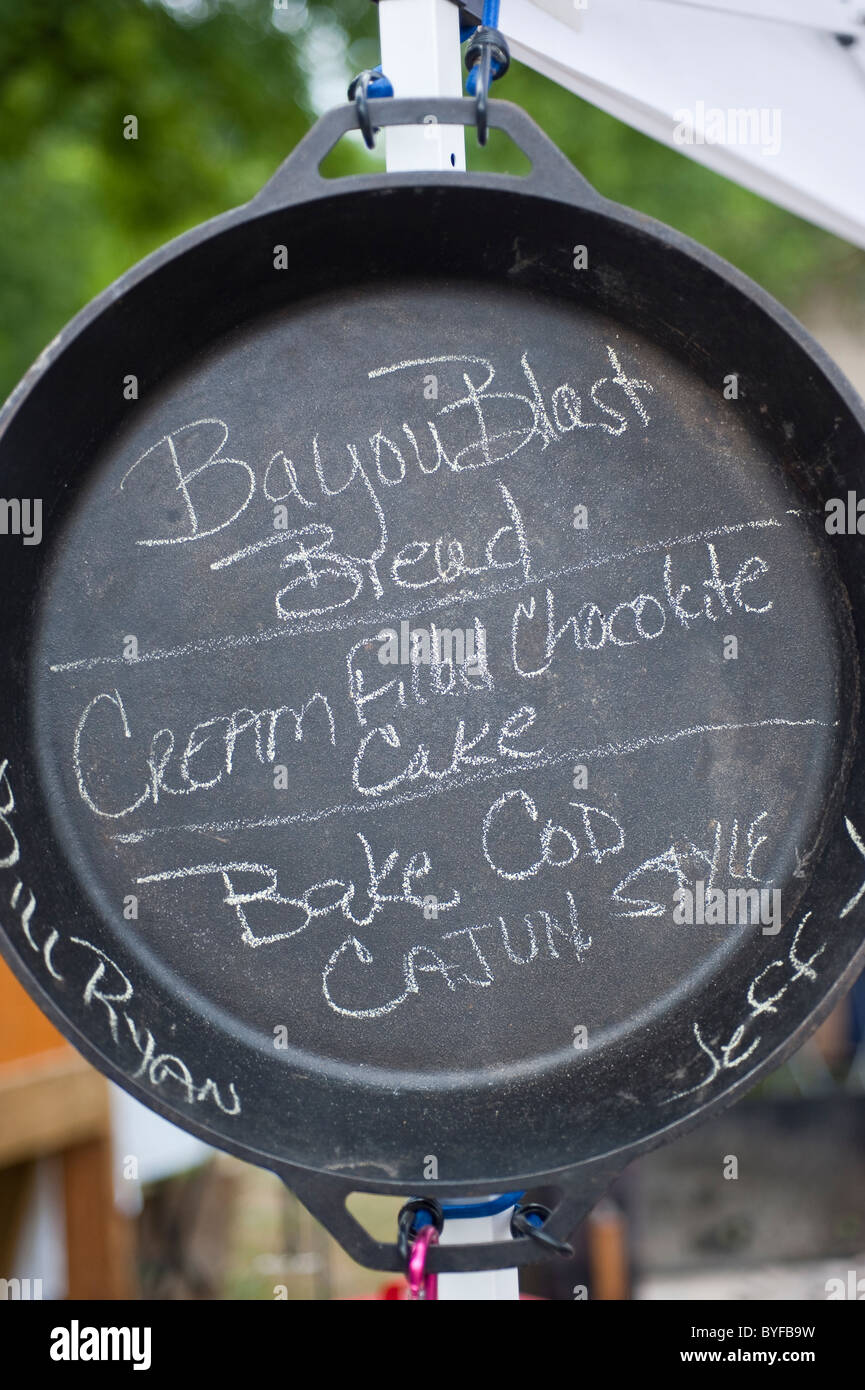 A menu is written in chalk in a dutch oven. - Stock Image