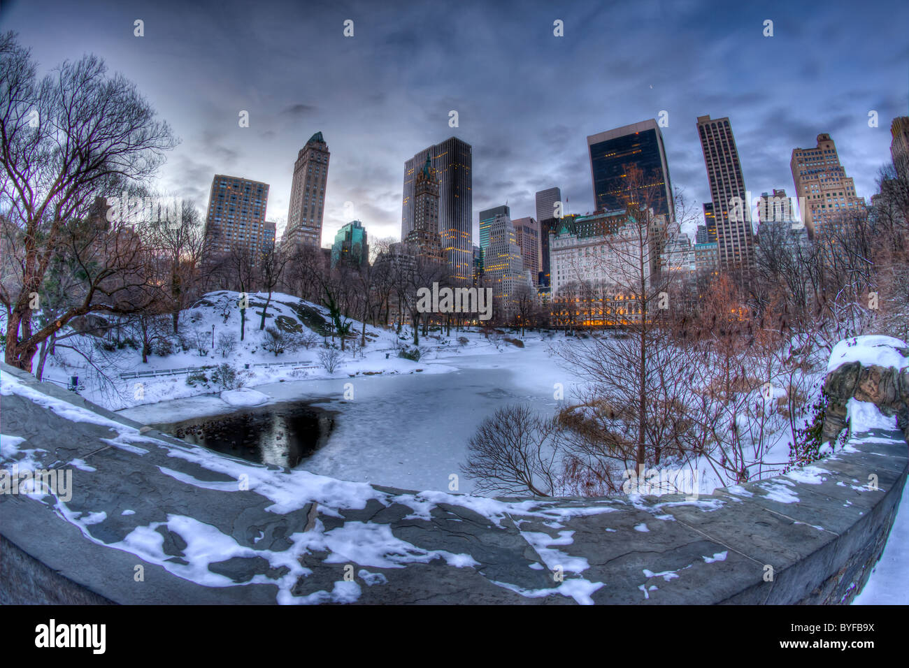 Fisheye View of the Pond from Gapstow Bridge in Central Park at Dawn on a Snowy Morning Stock Photo