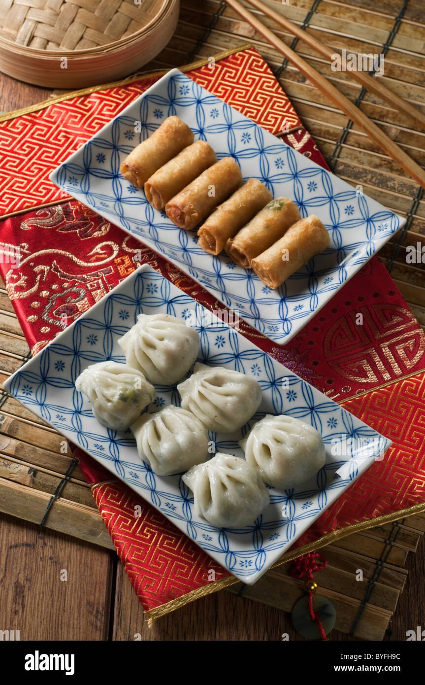 Steamed dumplings and spring rolls. Dim sum. - Stock Image