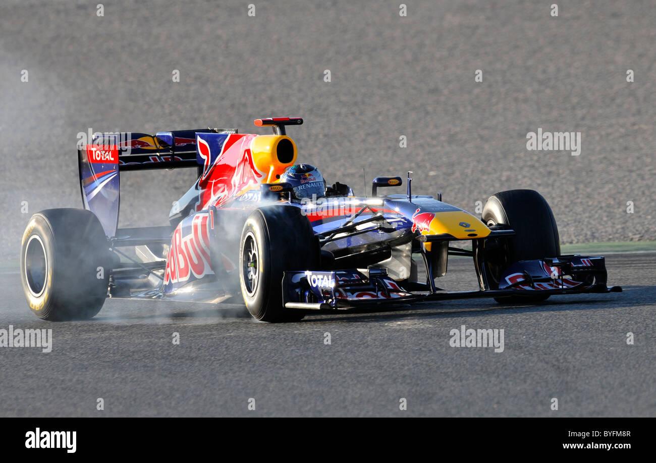 Sebastian Vettel GER In The Red Bull Racing RB7 Formula One Race Car