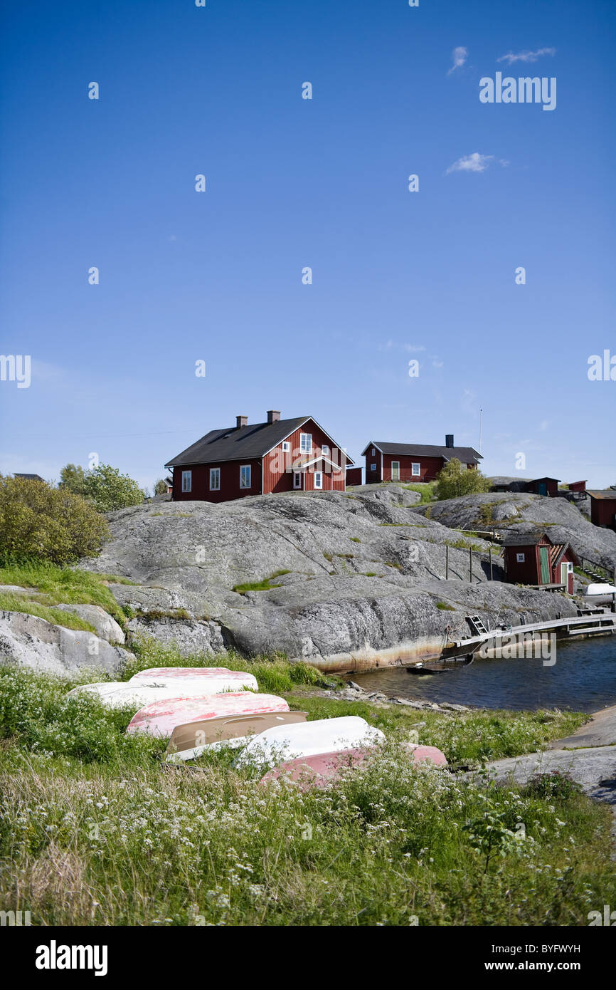Wooden houses on seaside - Stock Image