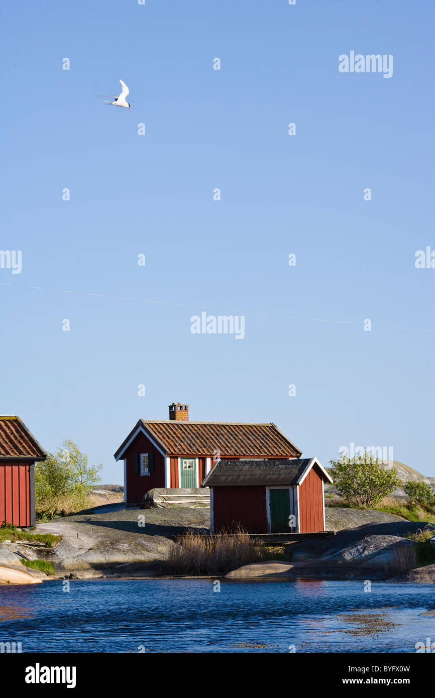 Wooden houses on seaside - Stock Image