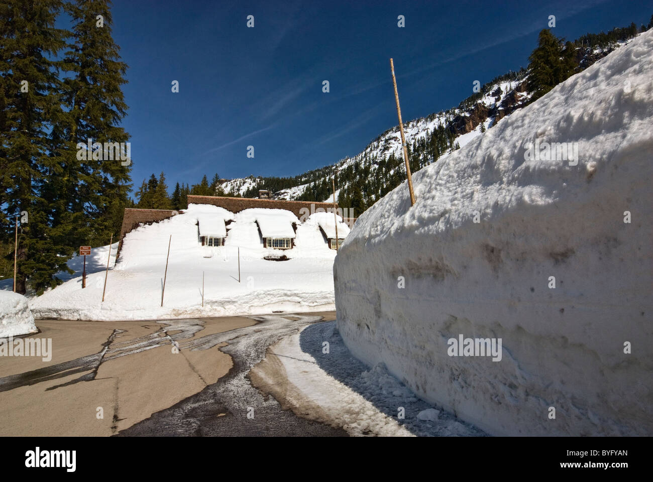 Walls of snow in winter around Steel Park Headquarters at Crater Lake National Park, Oregon, USA - Stock Image