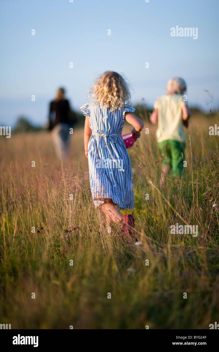 Three girls on meadow - Stock Image