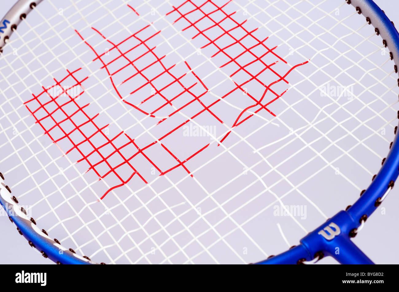 Broken Strings on a Badminton Racket - Stock Image
