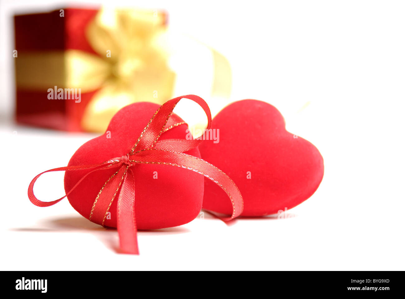 Two red hearts with gift box isolated on white background Stock Photo