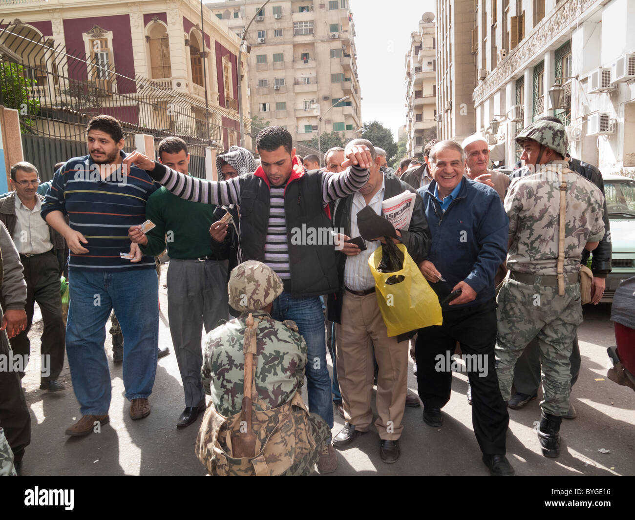 army frisking demonstrators on their way to Tahrir Square, Cairo, Egypt - Stock Image
