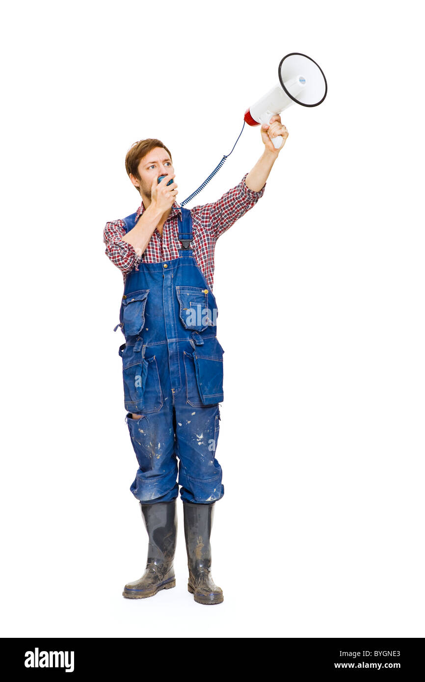 Studio shot of farmer speaking through bullhorn - Stock Image