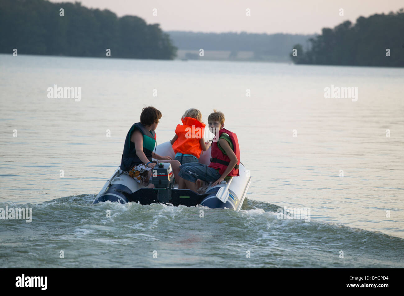 Father with sons on boat - Stock Image