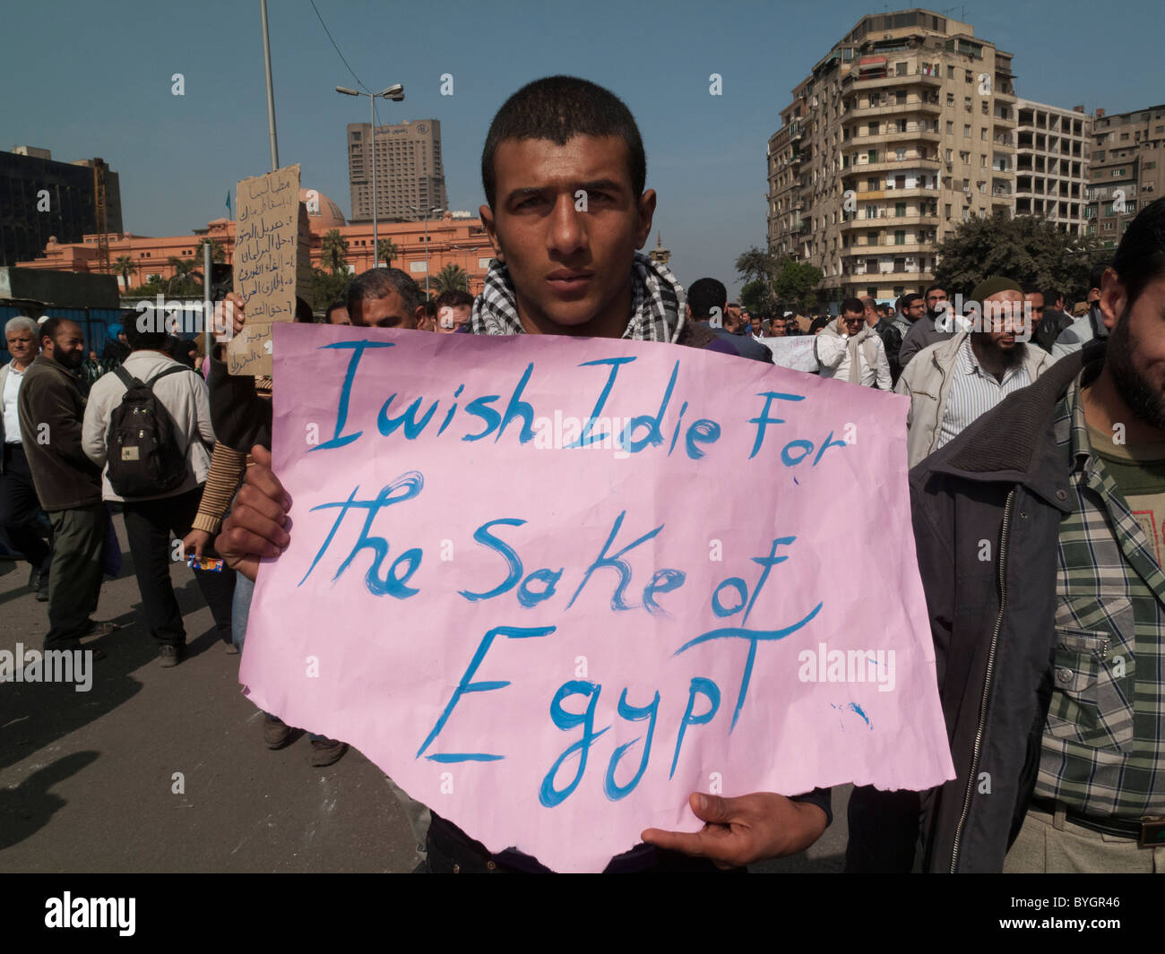 protestor with sign I wish I die for the sake of Egypt, Tahrir Square, Cairo - Stock Image