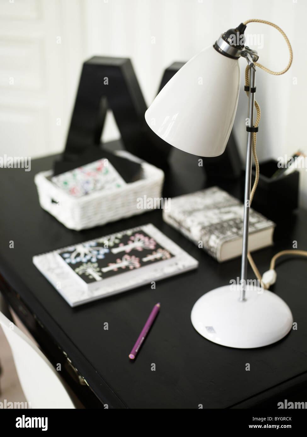 Black and white-themed modern design home work desk - Stock Image