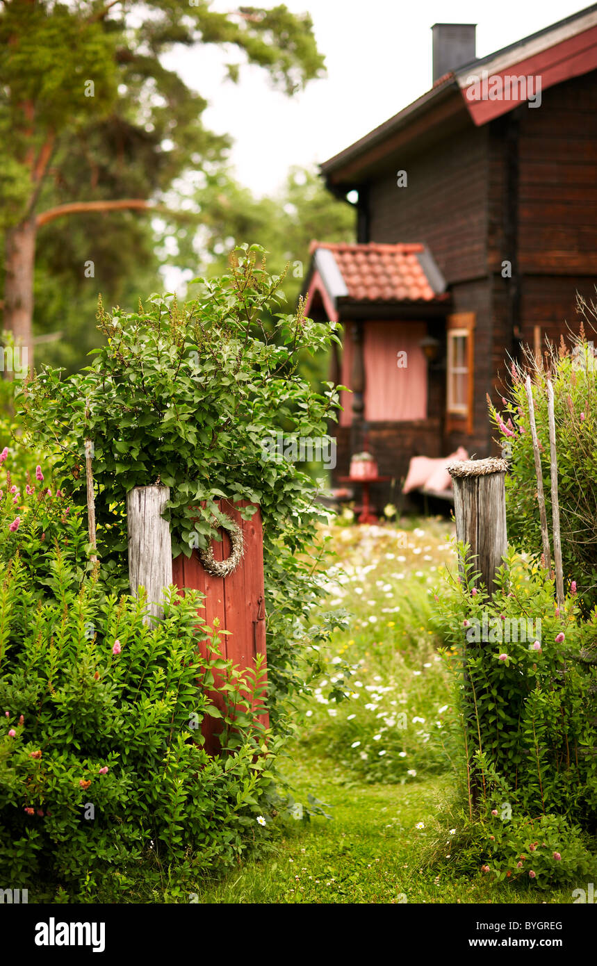 Rustic house with open front gate - Stock Image