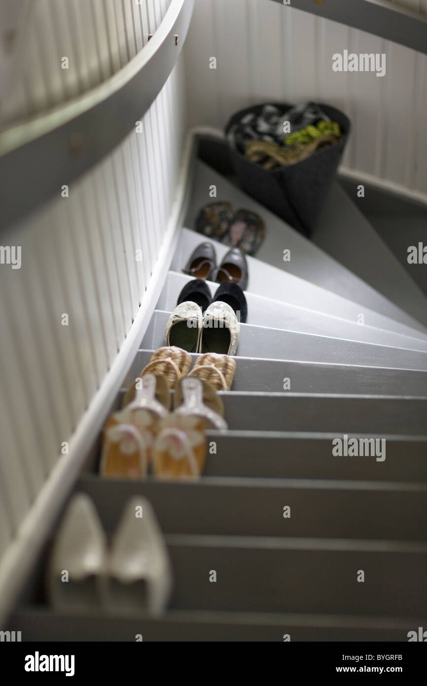Pairs of shoes in row on stairs - Stock Image