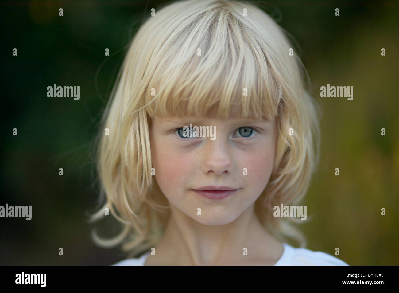 Portrait of blonde girl outdoors - Stock Image