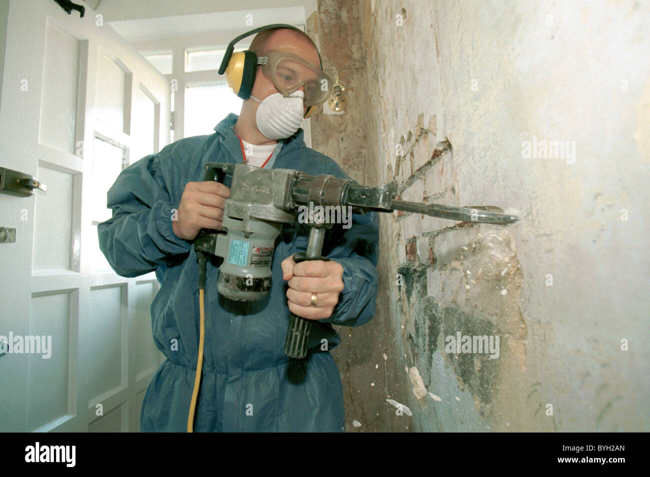 Damp Proofing. Drilling wall readiness for injection treatment - Stock Image