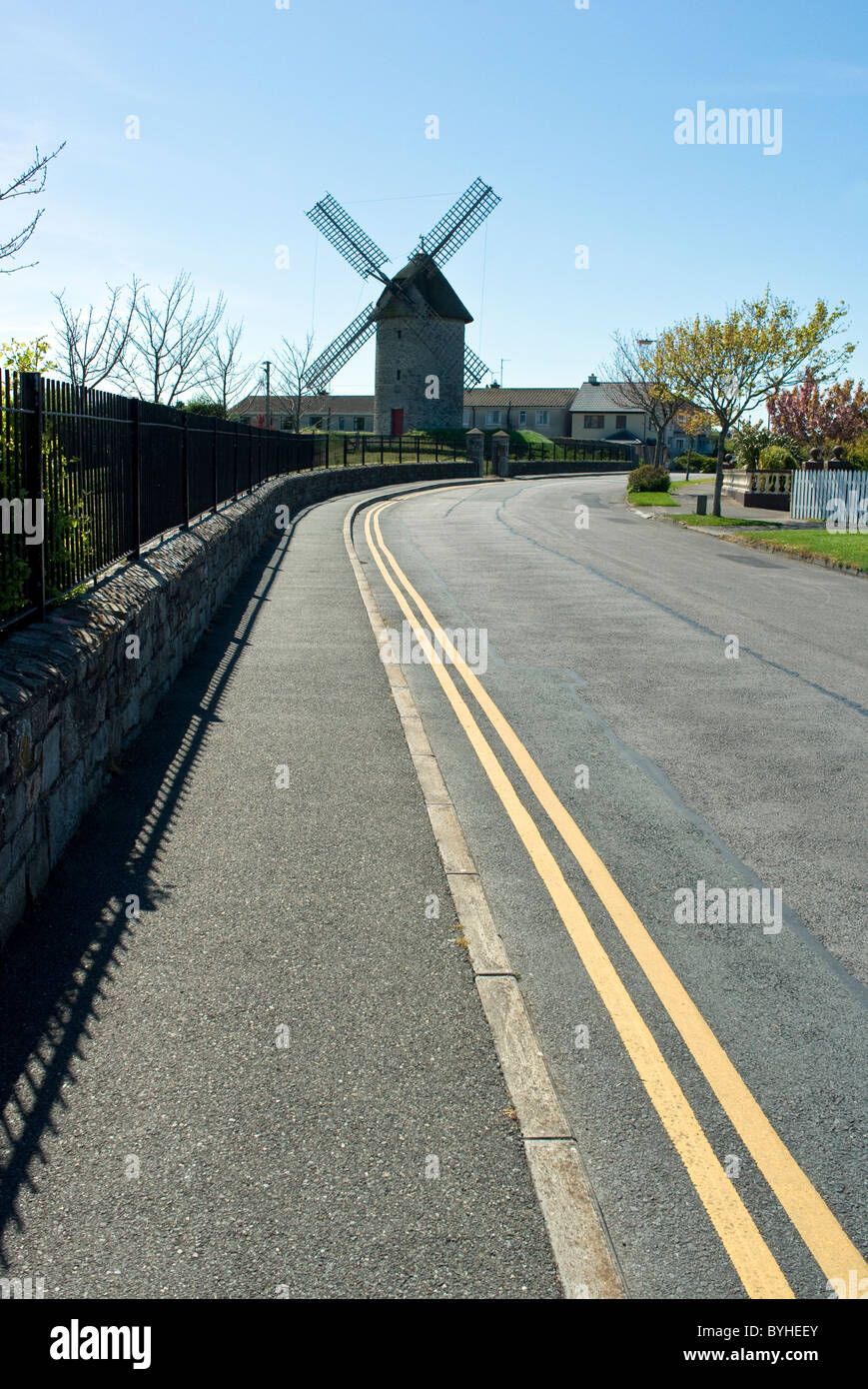 A road and path leading up to one of the restored windmills at Skerries Mills Skerries north county Dublin Ireland - Stock Image