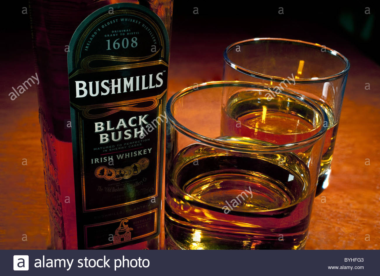 Arrangement of glasses and bottle of Bushmills Black Bush, a fine blended smooth Irish whiskey made in Antrim Northern - Stock Image