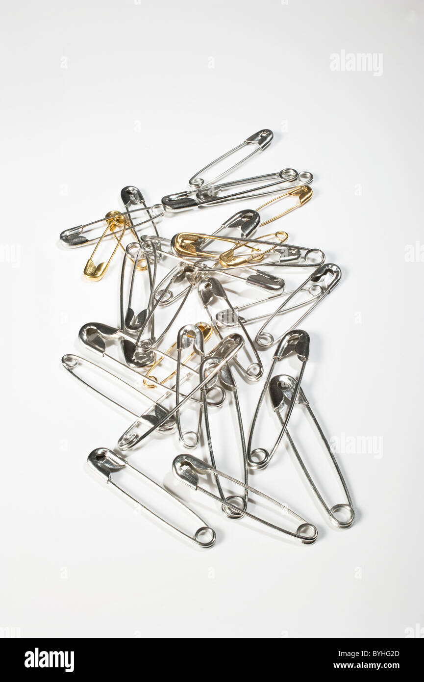 Brass and steel Safety pins - Stock Image