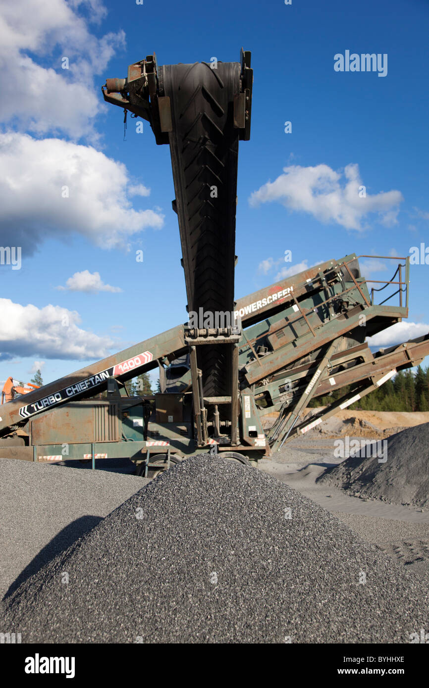 Powerscreen Turbo Chieftain 1400 screening device with conveyor belt at a rock quarry , Finland - Stock Image