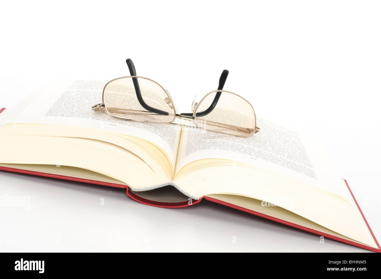 Open book with glasses - Stock Image