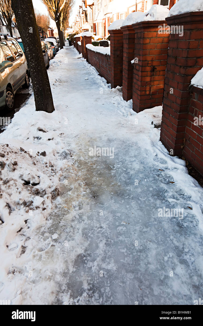 Ice on pavement dangerous and slippery Cardiff Wales UK - Stock Image