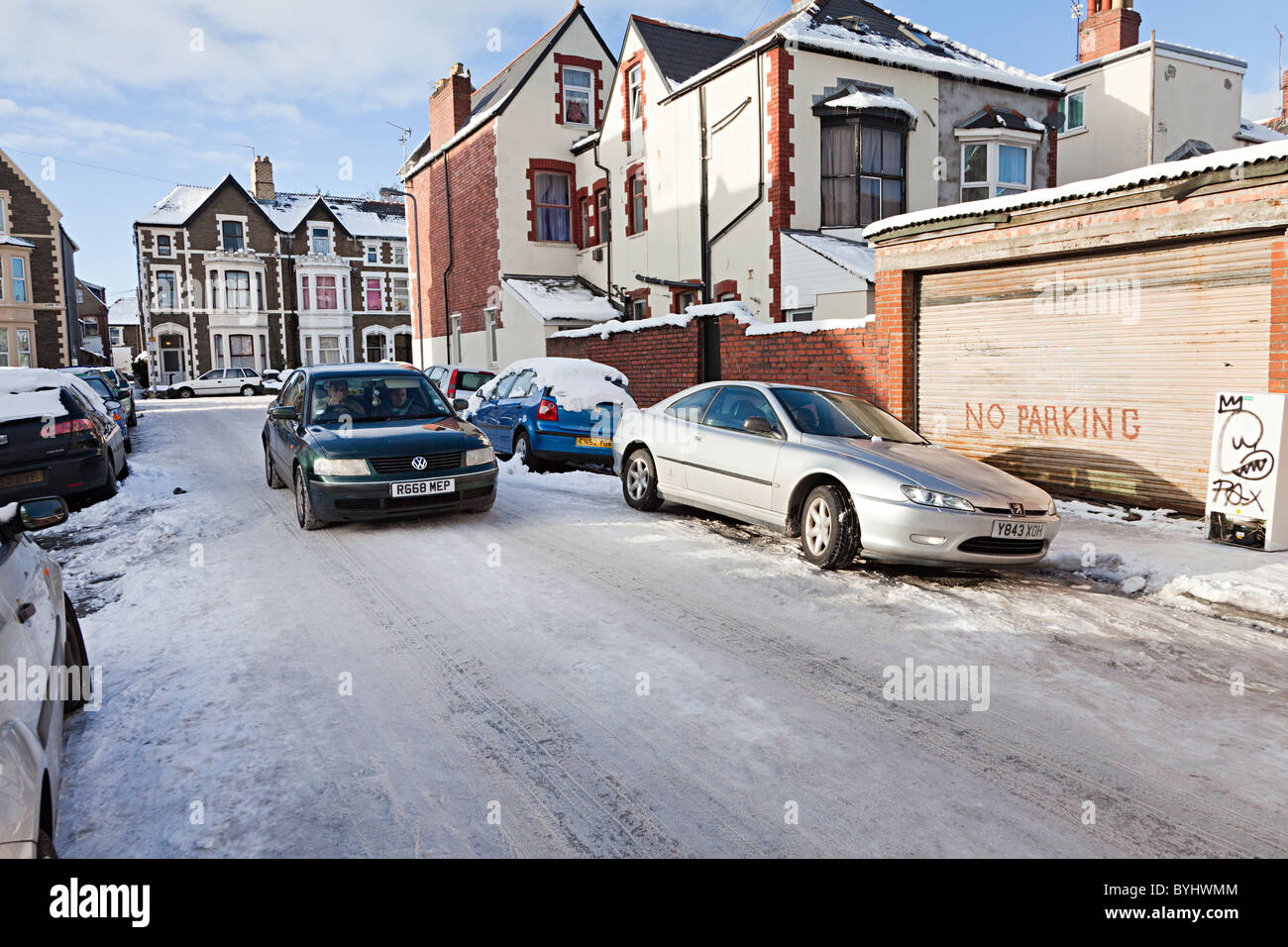 Car driven on city icy street Cardiff Wales UK - Stock Image