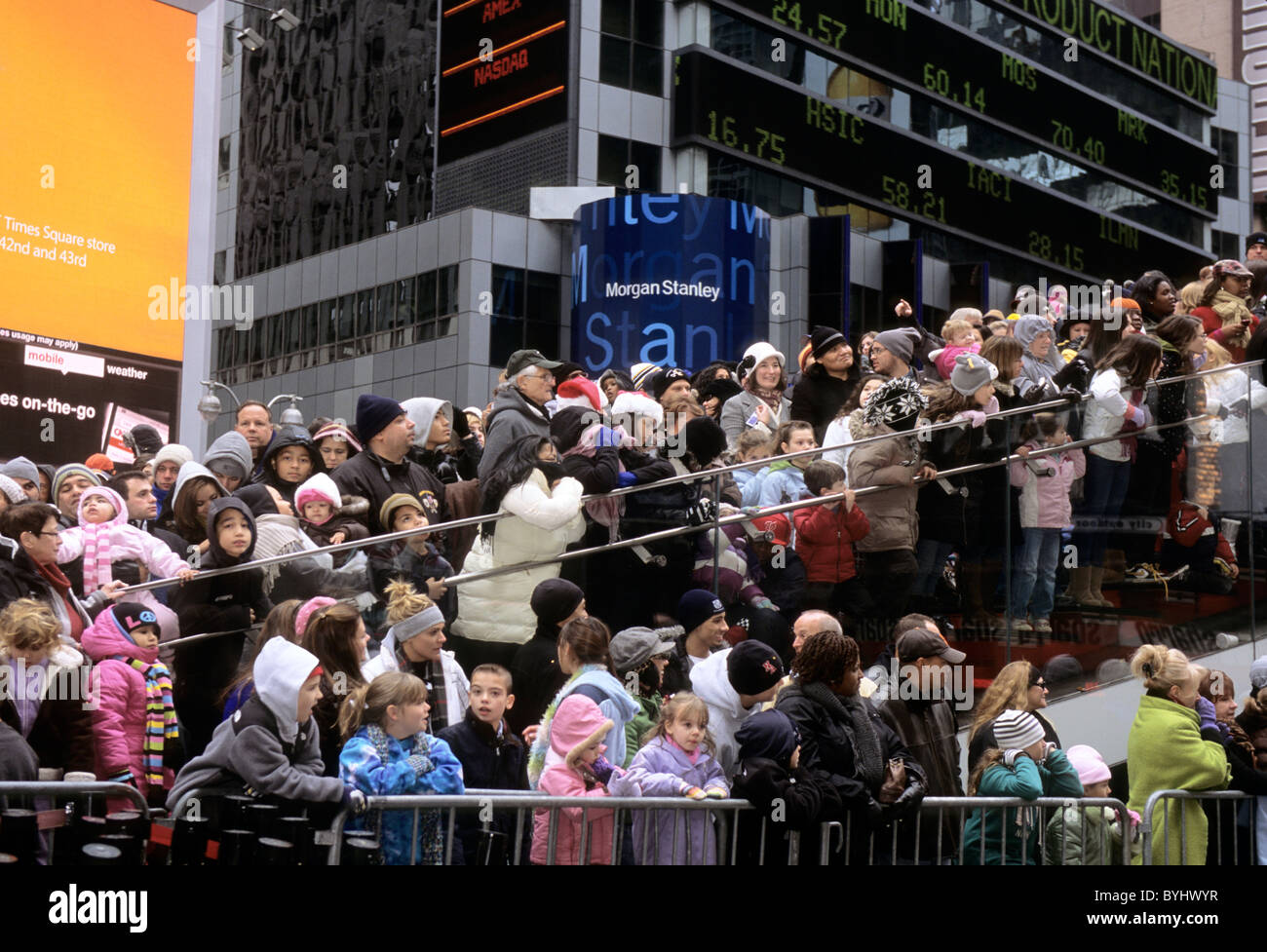 New York City Times Square and Broadway Crowd Watching Macy's Thanksgiving Day Parade USA - Stock Image