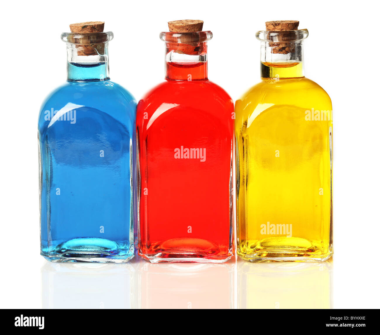 Blue, red, and yellow bottles - Stock Image