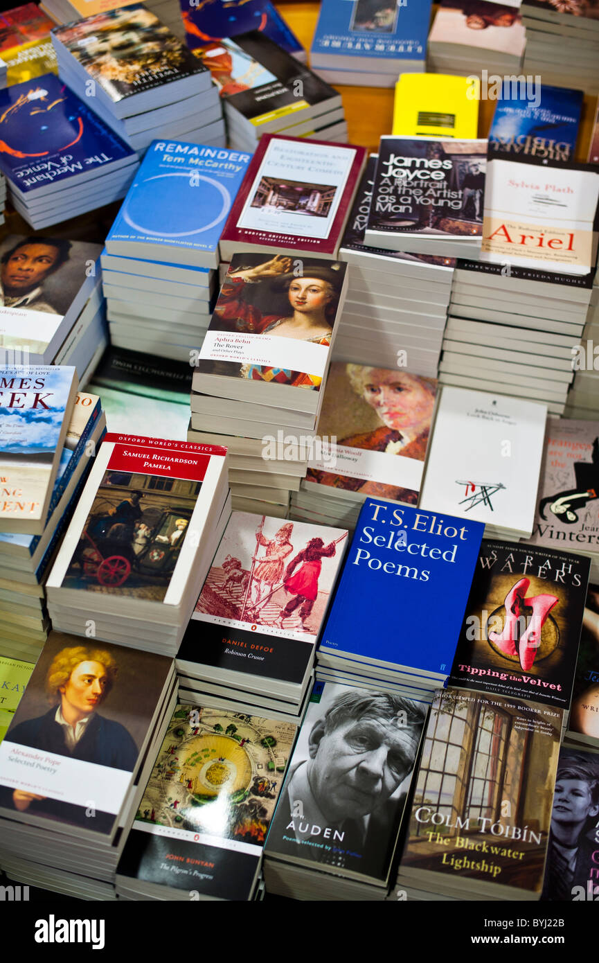 Stacks of english literature drama and poetry paperback textbooks in a university bookshop uk - Stock Image