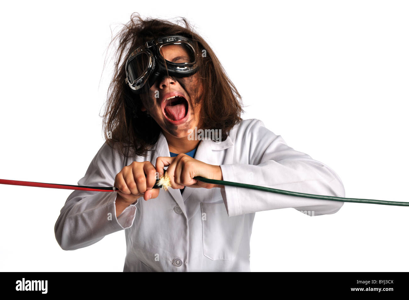 Young girl in laboratory gear being shocked by electricity isolated over white background - Stock Image