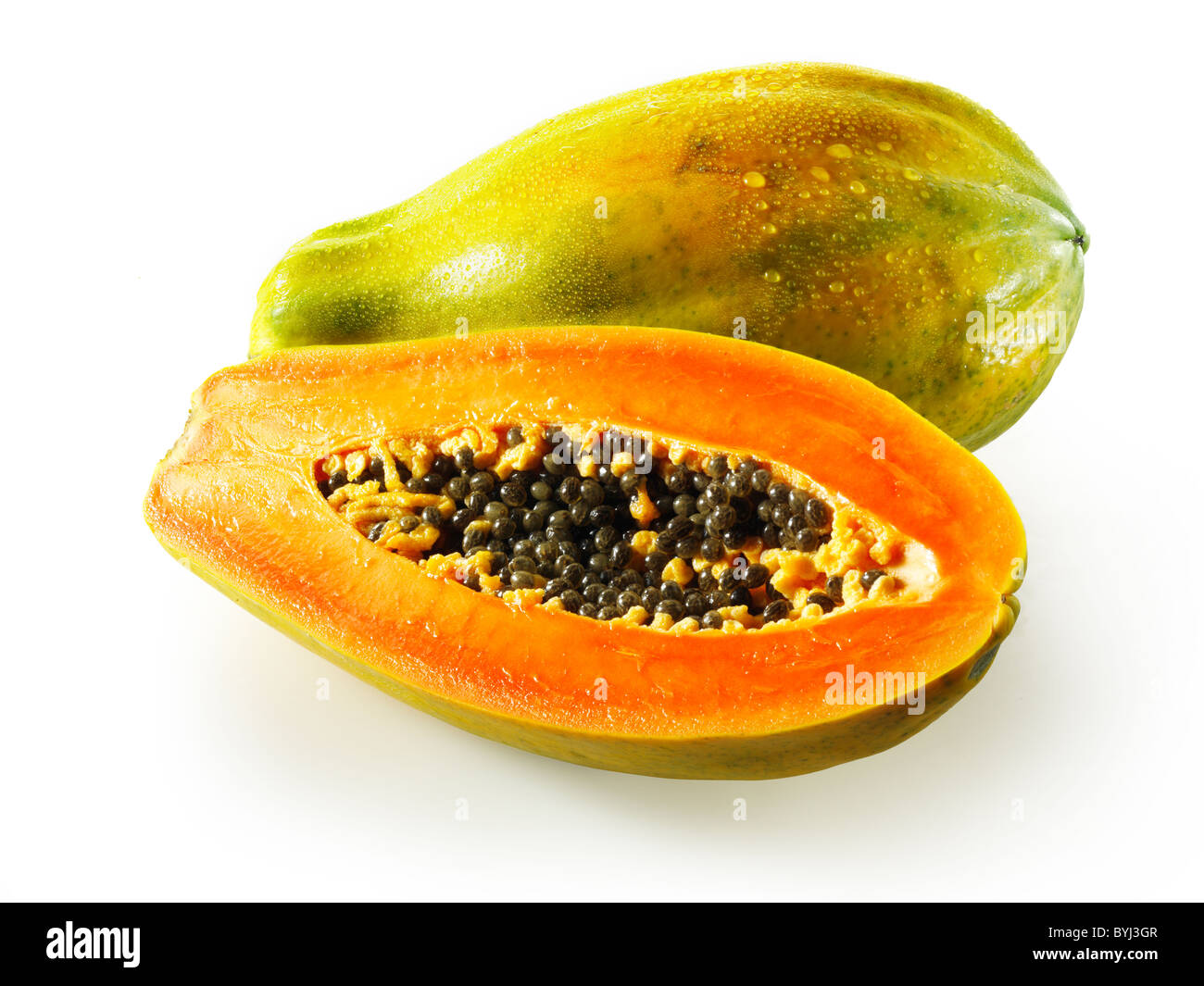 Fresh Formosa papaya cut, against a white background as a cut out - Stock Image